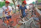 共享单车方便之余岂能乱放?红星路社区志愿者服务及时跟上